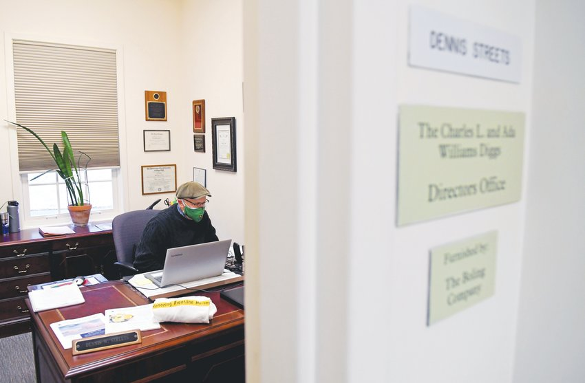 COA director Dennis Streets in listens in on a conference call with Chatham County Public Health Director Mike Zelek in March.