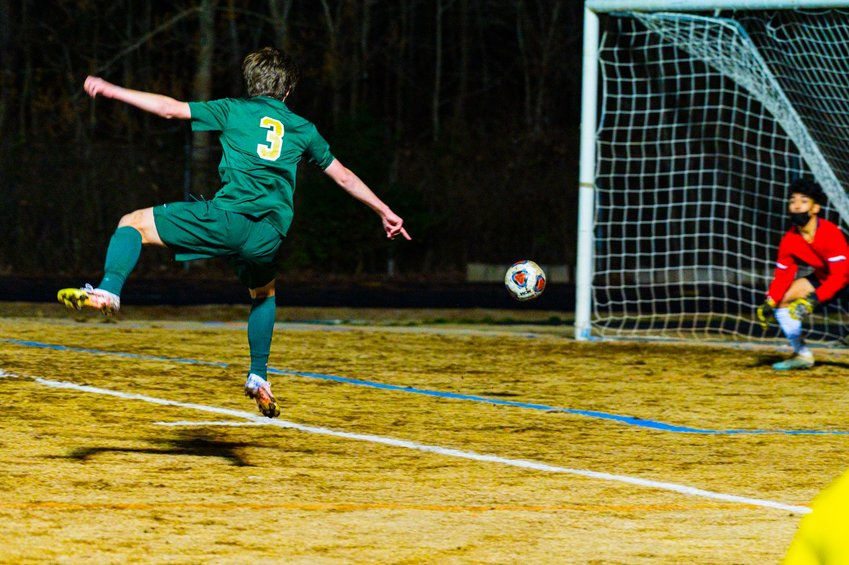 Northwood senior forward Burke Waudby fires a shot toward goal during the Chargers' 4-0 win over Orange on Wednesday. Northwood head coach Kevin Forster was impressed with his team's ability to create 'a lot of goal-scoring opportunities.'