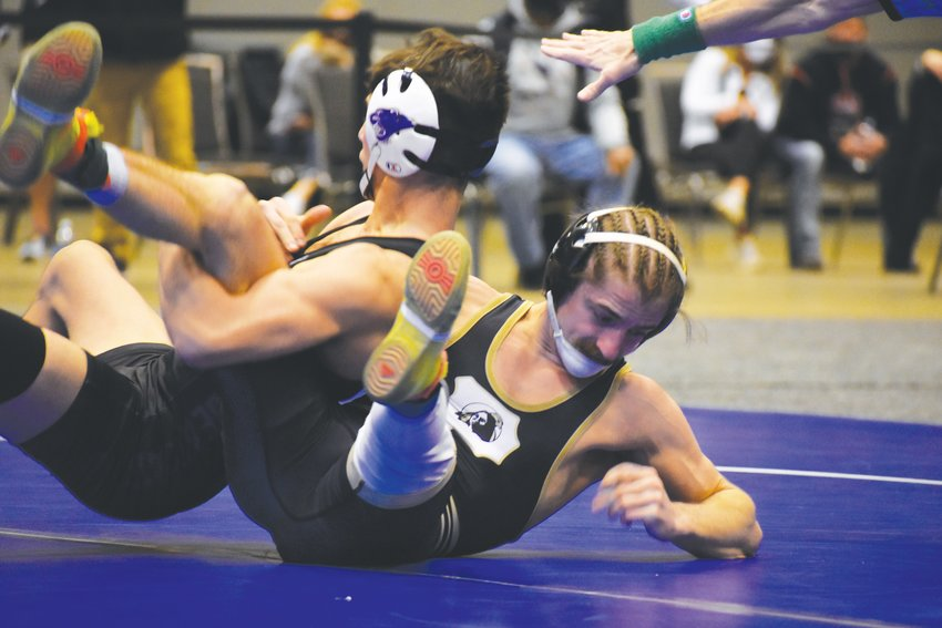 UNC Pembroke senior, and former Chatham Central wrestler, Nick Daggett (right) takes down McKendree's Christian Mejia in the semifinals of the NCAA Division II Wrestling Championships in St. Louis this past weekend. He would defeat Mejia by decision, 6-5.