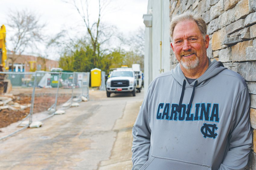 Greg Stafford, owner of what will become Pittsboro's 'SoCo' dining and retail center, stands amid the ongoing construction.