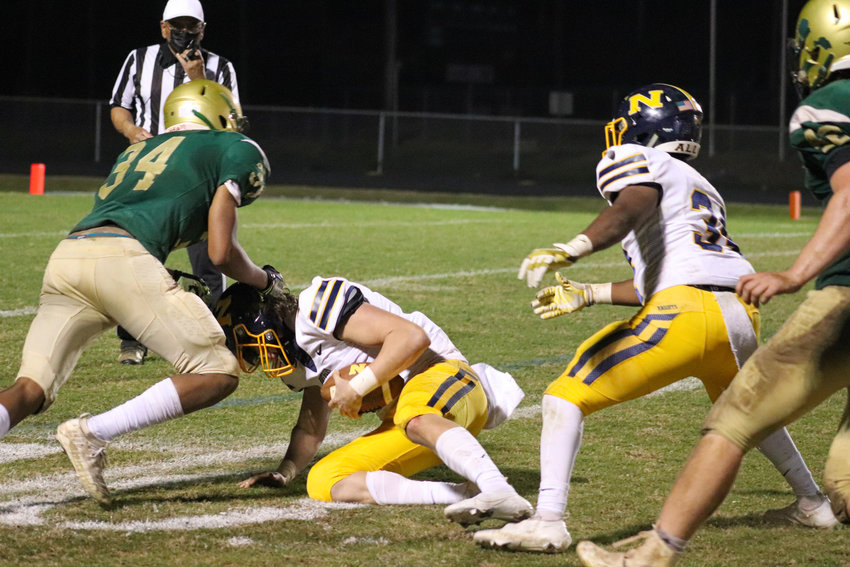 Northwood senior Kentrell Edwards (34) sacks Northern Durham quarterback Kyle Barnhill during the fourth quarter of the Chargers' 44-12 win on Thursday, April 8, in Pittsboro.