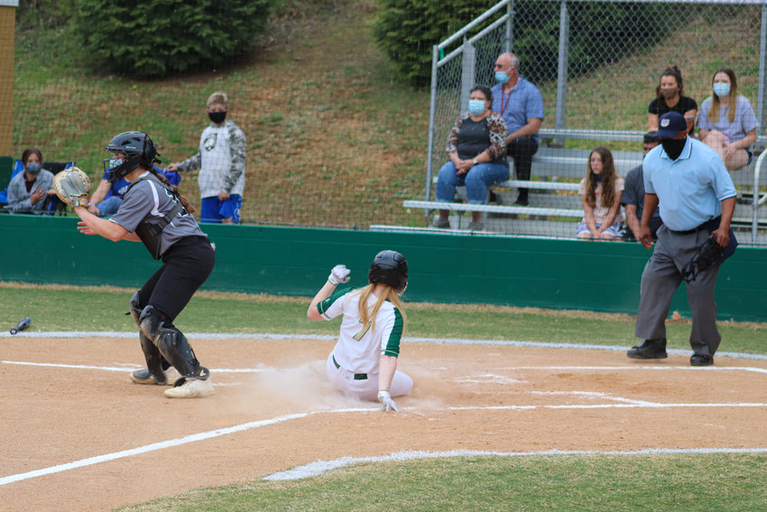 Northwood freshman Sarah Warfford slides across home plate in the first inning of her team's 16-6 win over East Chapel Hill on Thursday, April 8. Warfford went 3-for-5 with 2 RBI on the night.