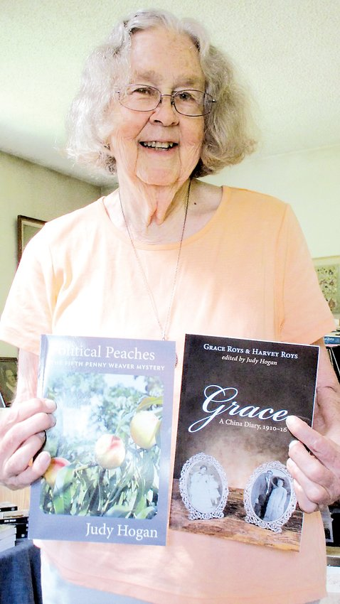Prolific author Judy Hogan holds two earlier books and will have her newest title, the twelth featuring fictional slueth Penny Weaver, available for purchase February 1.