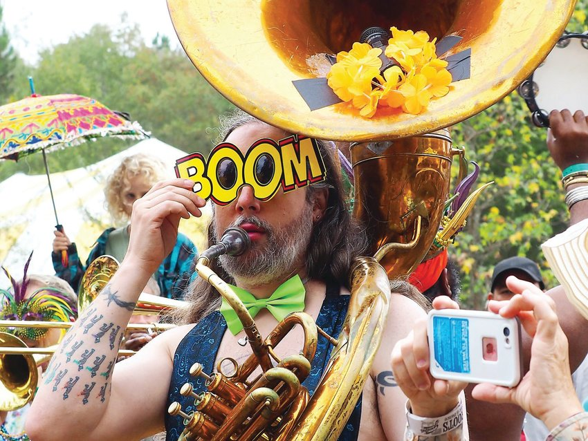 The Bulltown Strutters Parade is a Shakori Grassroots Festival tradition. Musicians play New Orleans music and stomp through the festival on the way to a full performance at the Dance Tent.