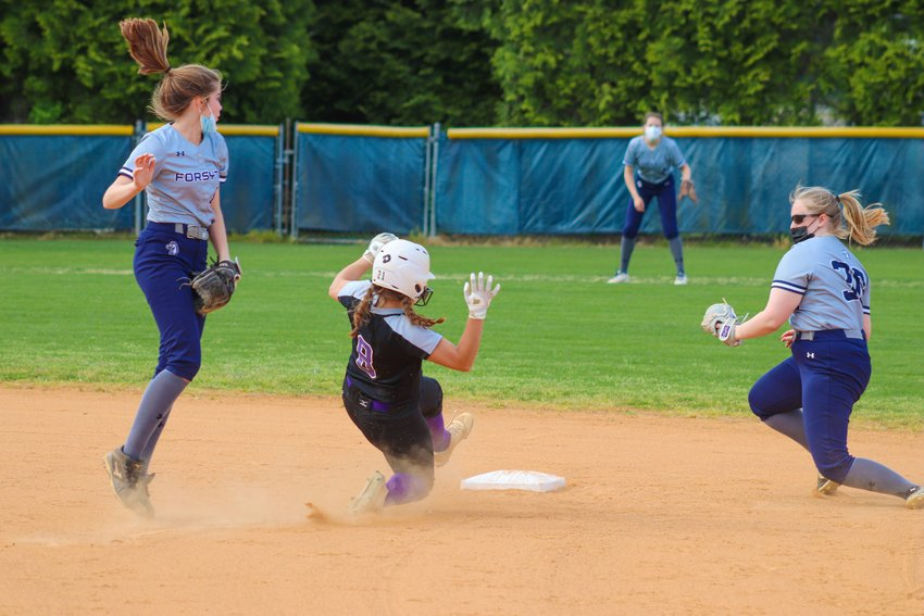 Chatham Charter junior Taylor Jones (8) slides into second base in the first inning of her team's 4-3 loss to Forsyth Country Day on Thursday, April 15. Jones was one of four Knights with a hit on the day.
