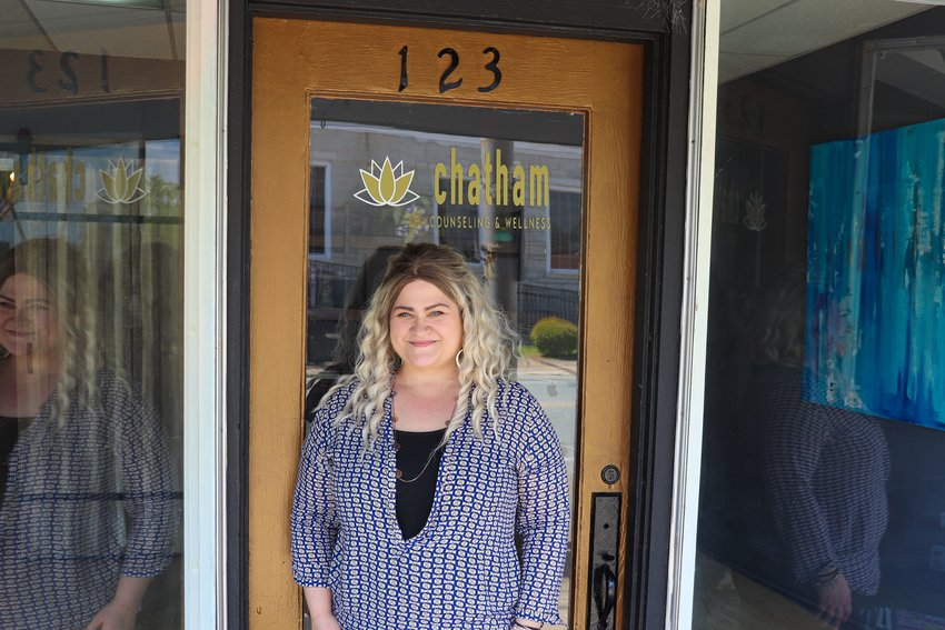 Ashleigh Glover, shown here in front of her business, Chatham Counseling and Wellness Center in downtown Siler City this past Thursday. She has offered pro-bono services to anyone hurt by Siler City Pastor Oscar Jimenez's alleged acts.