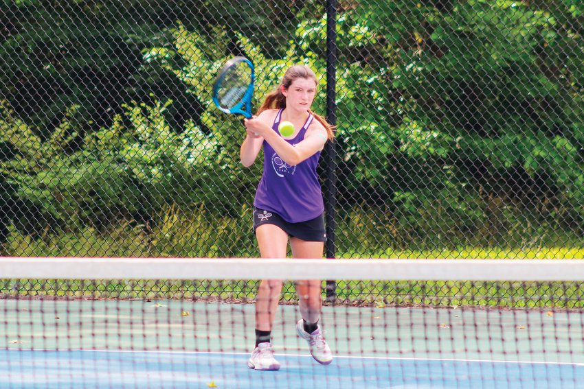 Chatham Charter freshman Elphie Spillman swings at a ball in her singles match against Chatham Central senior Sophie Phillips in the Knights' 6-3 loss to the Bears. Spillman went on to defeat Phillips, 10-4, but lose to her in their doubles match.