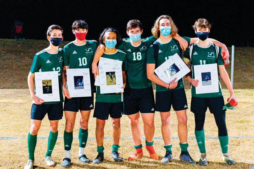 The six Woods Charter seniors (from left to right: Nicholas Mann, Kyle Howarth, Marky Noronha, Justin Galiger, Eli Terrell, Elijah Heatherington) pose together during senior night celebrations on March 10. Four of the six seniors (Howarth, Noronha, Galiger, Heatherington) were selected to the 2020-21 Central Tar Heel Men's Soccer All-Conference team.