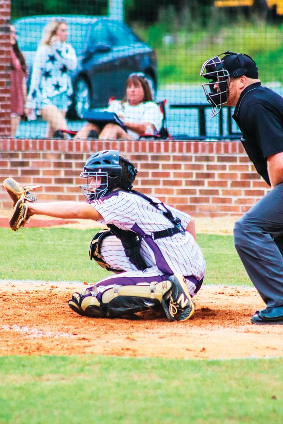 Chatham Charter senior catcher Jacob Brannon readies for a pitch on his senior night on Monday against Cornerstone Charter Academy in Siler City. Brannon led his team with two hits, including a double.