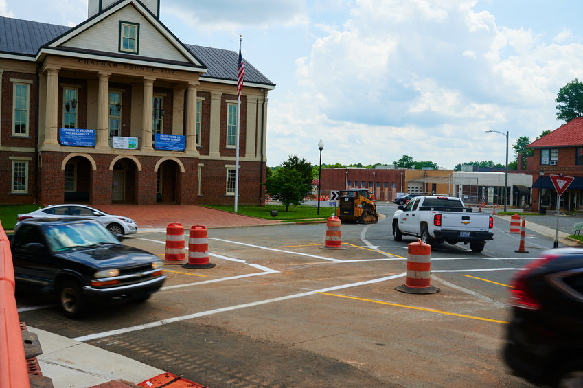 Pittsboro's traffic circle re-opened for traffic Monday, but work on the $2.48 million project continues.