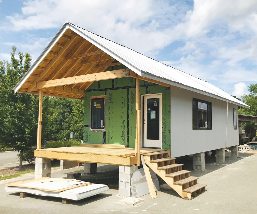 The Chatham Cottage, handcrafted by Central Carolina Community College students enrolled in the college's Building Construction Technologies and Sustainable Technologies programs, will be up for auction beginning Saturday via an online auction platform, www.charityauctionstoday.com. The auction will open at 8 a.m.  on June 19 and closes at 5 p.m. on June 26..