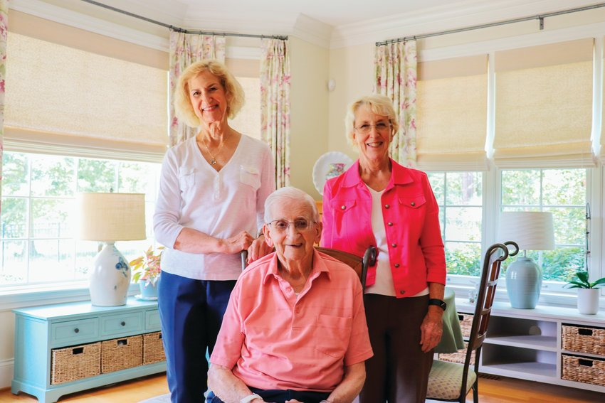 World War II veteran Wesley Hart, who's 102 years old, poses with his daughters Lynne Dyer (left) and Kathy Wakeman at the home he shares with Kathy in Chapel Ridge. Hart will be awarded the French Legion of Honor in a ceremony on Aug. 12.