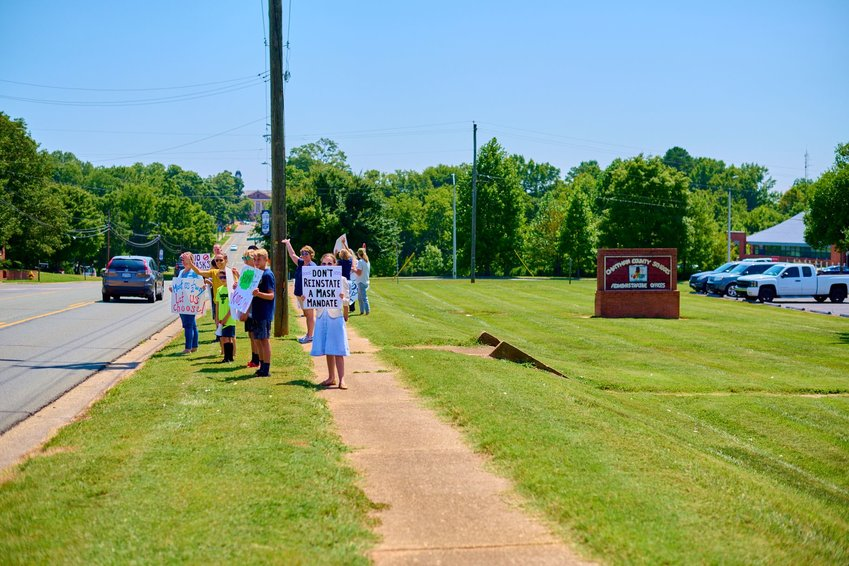 """Parents gathered at a """"Parent's Choice 4 Masks Rally"""" outside of the Chatham County Schools Board of Education's specially called meeting on Thursday."""