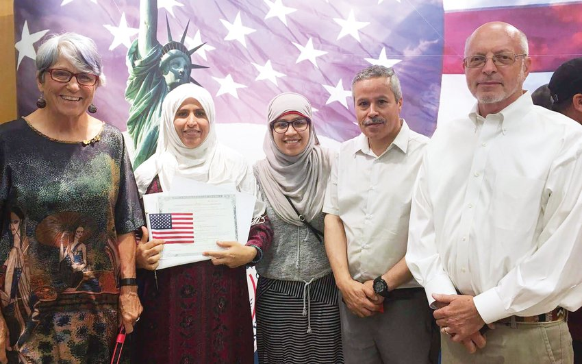 Suryah Zahmadi poses with her tutor Joanne Caye (left), her daughter Shaimaa, her husband Abdul and mock examiner Dan Freehling (right) on July 19, 2019, the day she took her oath of allegiance as a new U.S. citizen. Zahmadi lives in Siler City with her family.
