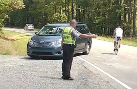 A Chatham County Sheriff's Deputy assists in directing traffic at one of the Radha Krishna Temple of N.C.'s special events.