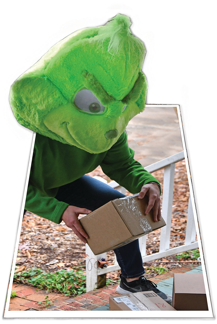 The 'Grinch' prepares to take several packages from a victim's front porch. 'Porch Pirates' with sticky fingers are out during the holiday season.