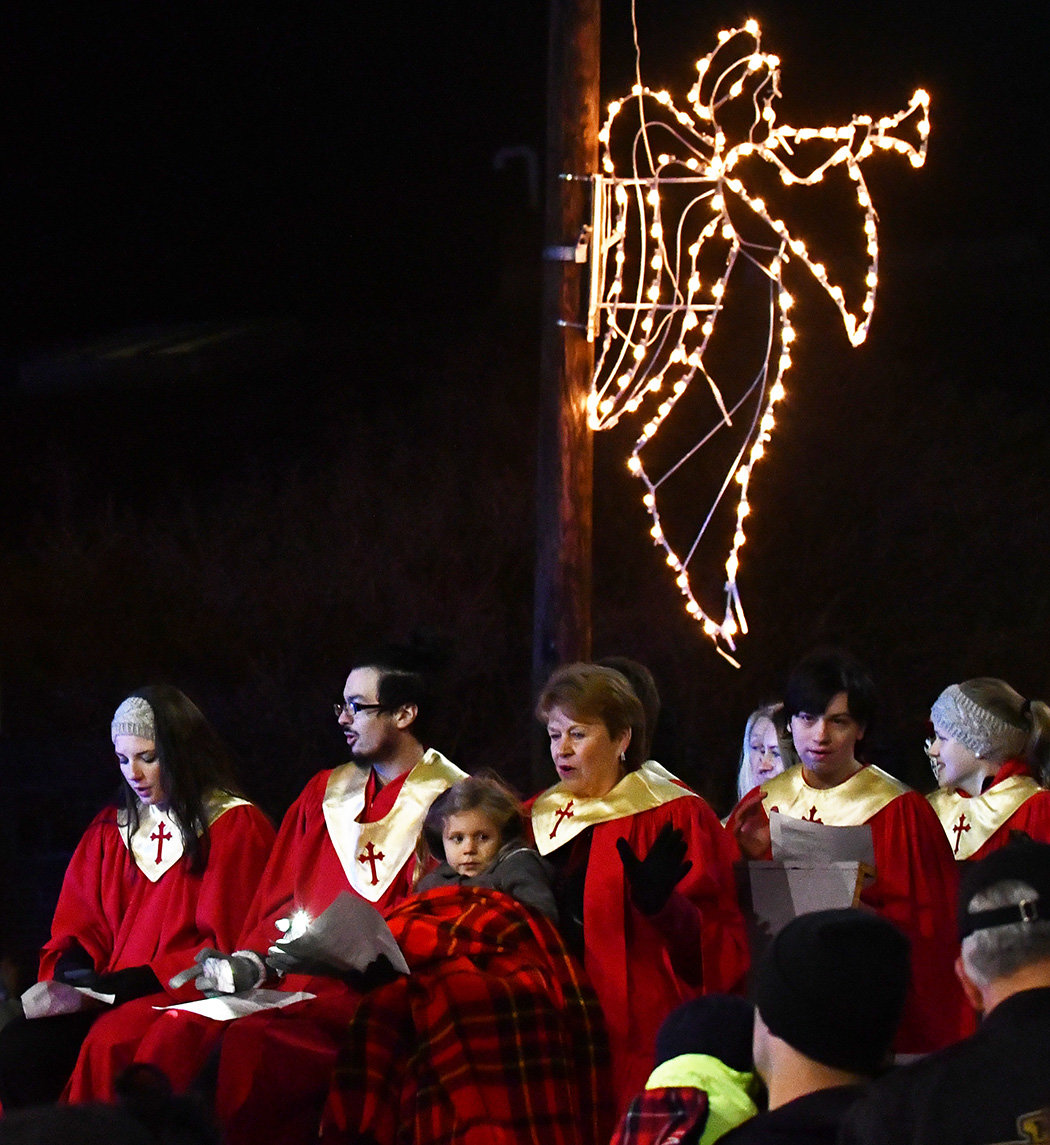 The choir gets some help from an angel Thursday night in Siler City.