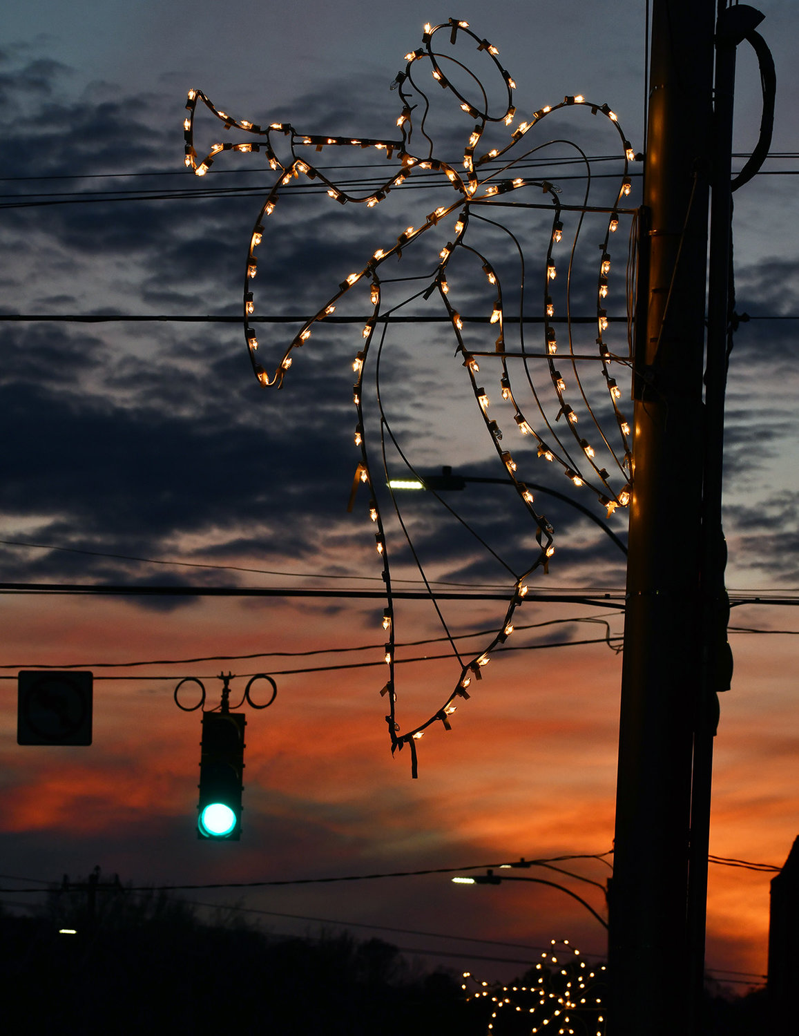 The sun helps to paint the western sky in Siler City Thursday night .