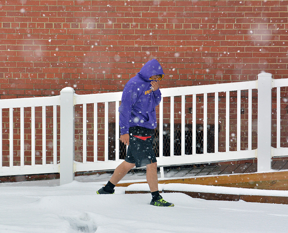 Walking in a winter wonderland. Actually, he was headed back to his car after a workout at the gym.