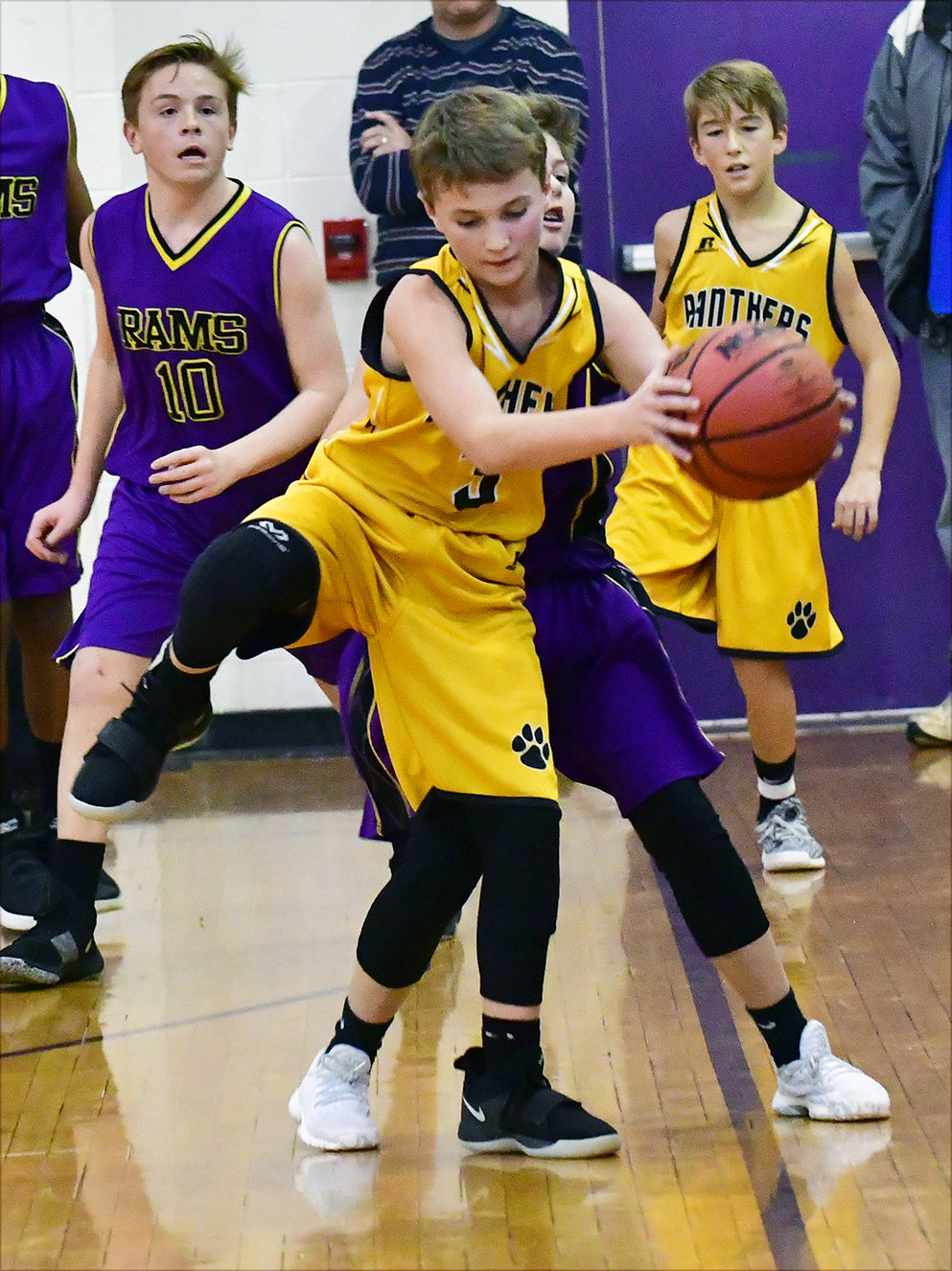Bennett's Jacob Gilliland pulls in the ball before it goes out of bounds.