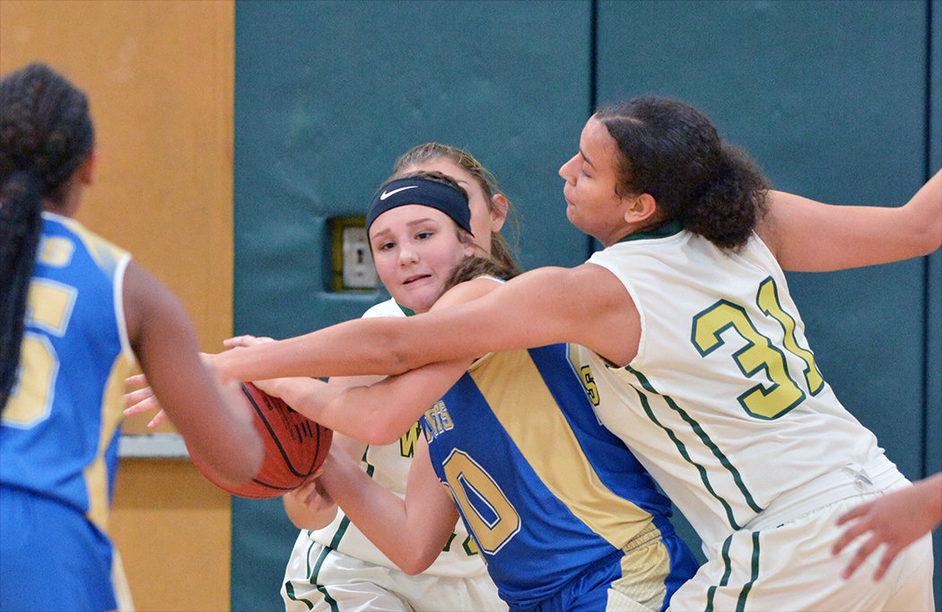 Jet Ashlyn Ray, with ball,  is caught in the middle of Eastern's Tehya Jordan.