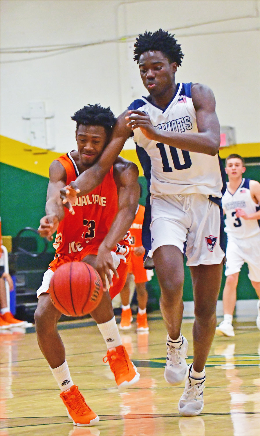 Wallace-Rose Hill's Zalen Hall, left, tries to steal the ball from Apex Friendship's Jayden Beloti in first round action of the 1st Bank Charger Classic.