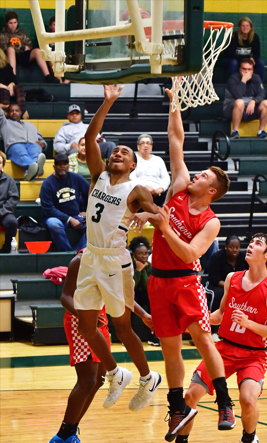 Northwood's Justin Brower floats a shot up to the basket against Southern Alamance Thursday night. Northwood won the game to advance to play Lee Senior at 7 on Friday.