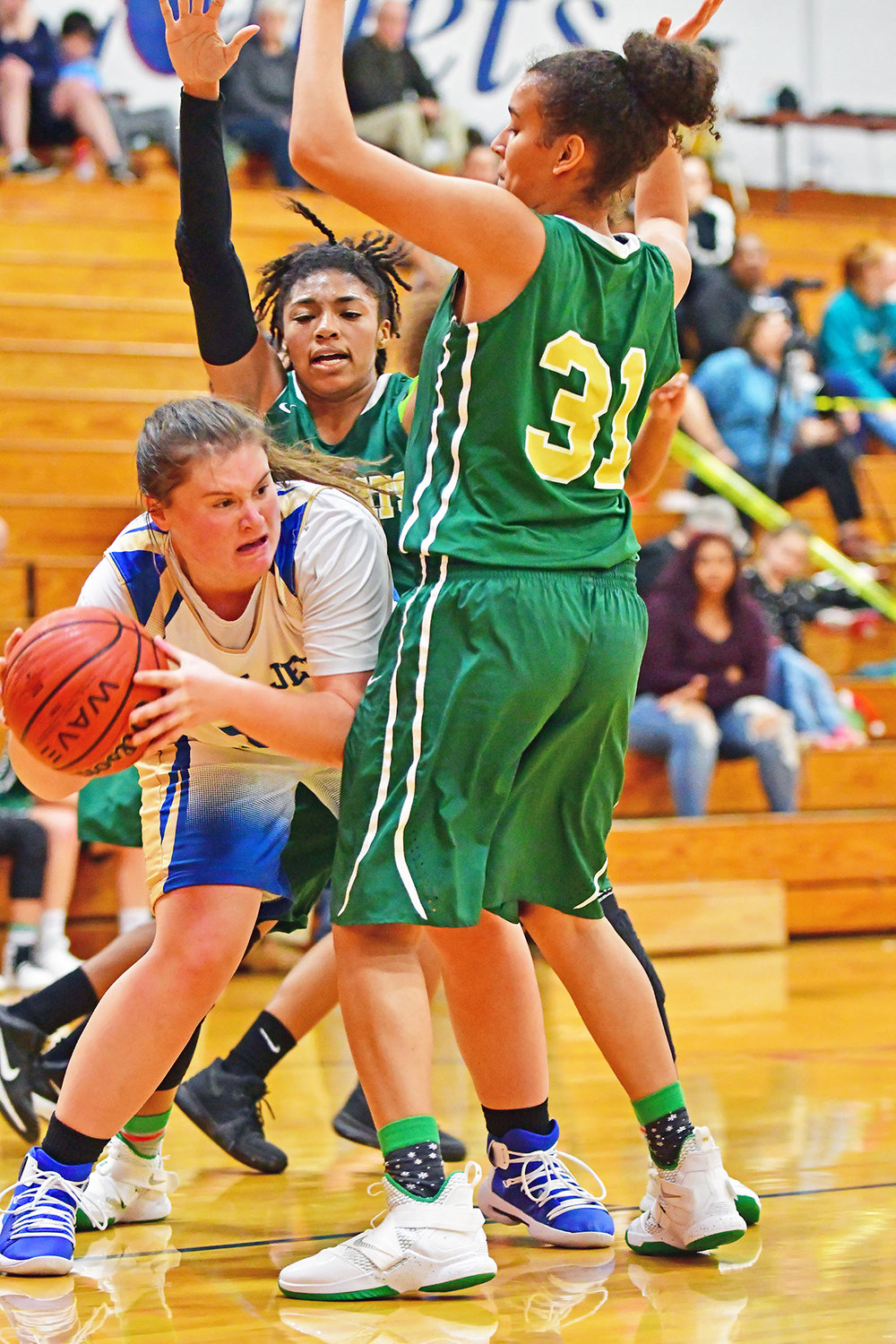 Lady Jet Jocelyn Mitchell looks for a way to pass the ball around the Eastern Randolph's defense.