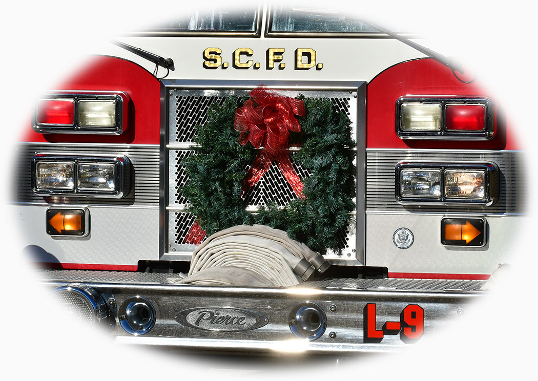 A Christmas wreath hangs proudly on Siler City ladder truck Saturday.