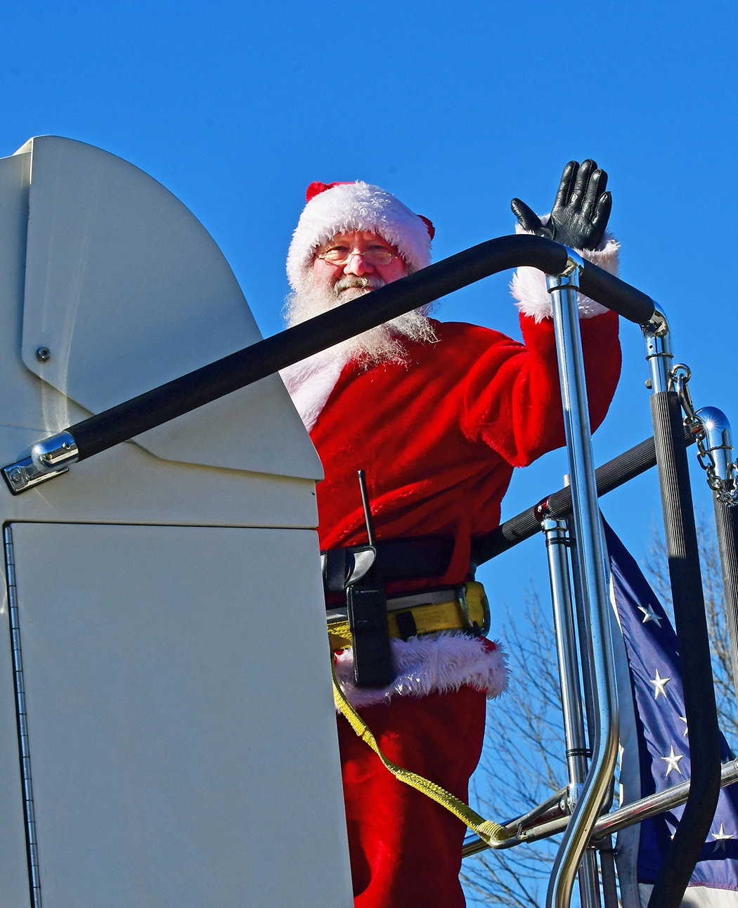 And to all a good . . . afternoon. Santa waves from the back of Siler City's ladder truck as wide-eyed youngsters watch.