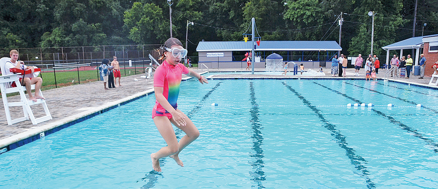 Siler City town manager Bryan Thompson's daughter Taylor was the first child to hit the pool when the Aquatic Center at Bray Park had its opening in August. The $1 million project was supported through grants and donations from individuals and organizations in Siler City.