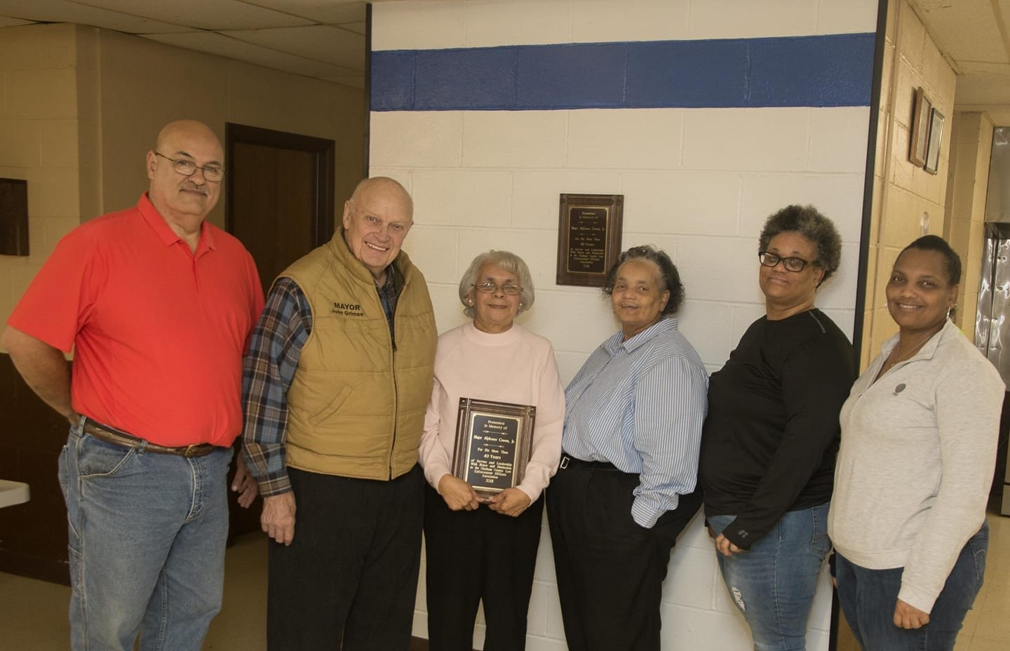 The late Al Craven, a Siler City law en-forcement officer for decades, was honored earlier this month by the Chatham County Law Enforcement Officer's Association. From left are Mike Koszulinski, president of the association; Siler City Mayor John Grimes, Craven's wife, Alice, and his daughters Lynn Craven, Renee Craven and Angela Cones.