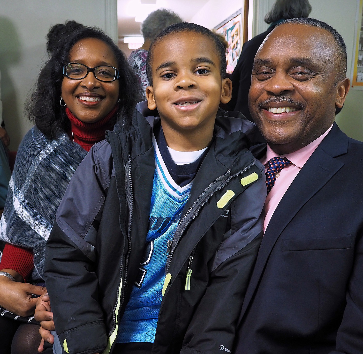 Representative Robert Reives II (right) attended the NAACP's MLK breakfast with his wife Cynthia and their son, T.J.