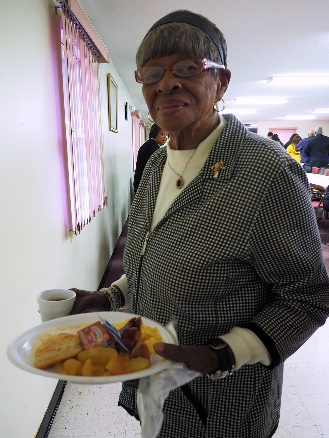 Swannie Durant of Siler City shows off her plate of breakfast goodies that were served at the breakfast.
