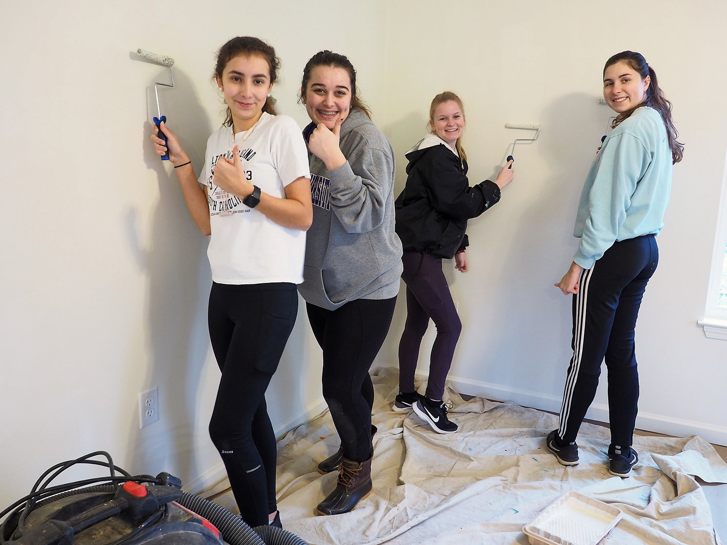 Volunteers were happy to help with the Habitat for Humanity build. Northwood juniors Amber Haley, Peyton Casey, Sarah Fowler and Jillian Hold worked on painting the interior of the home.