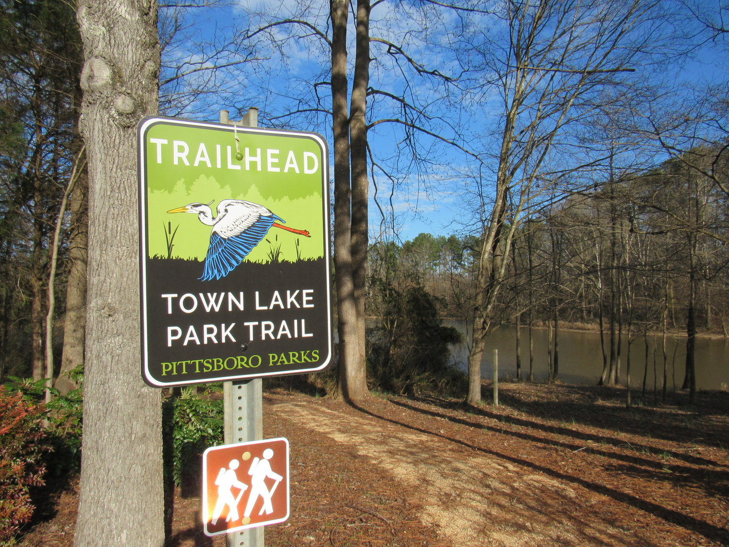 The trail at Town Lake Park in Pittsboro is just one of its several features, which include soccer fields and a lake for fishing.