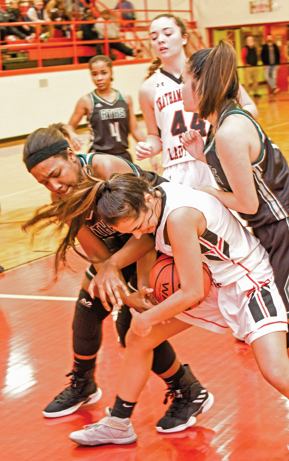 Chatham Central's Eliana Phillips (bottom right) fights for a loose ball on Tuesday evening down in Bear Creek in a 59-35 rout of Research Triangle Park.