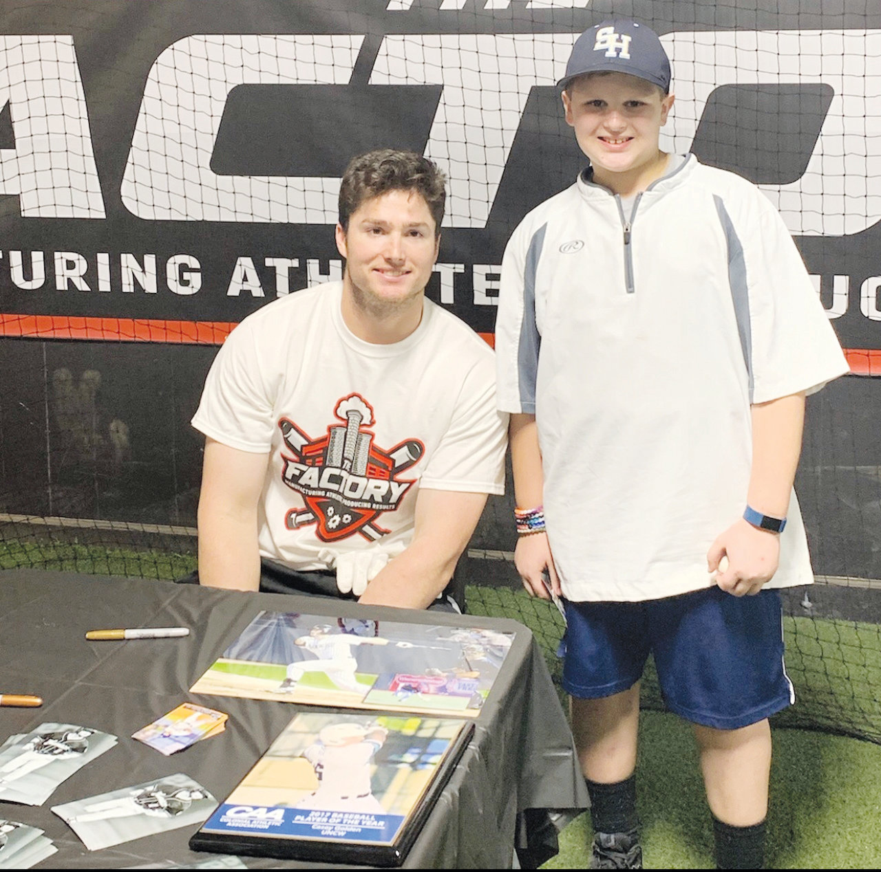 Casey Golden (left) poses with a local fan on Friday night at the Factory in Siler City. Golden hosted an event for area youth league players before heading out to Arizona on Sunday for the start of Spring Training.