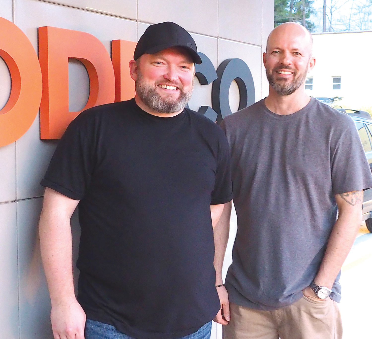 David Holt (left)  and Justin Ware are two of the four owners of ODDCO and are the designers and builders of its custom bar.