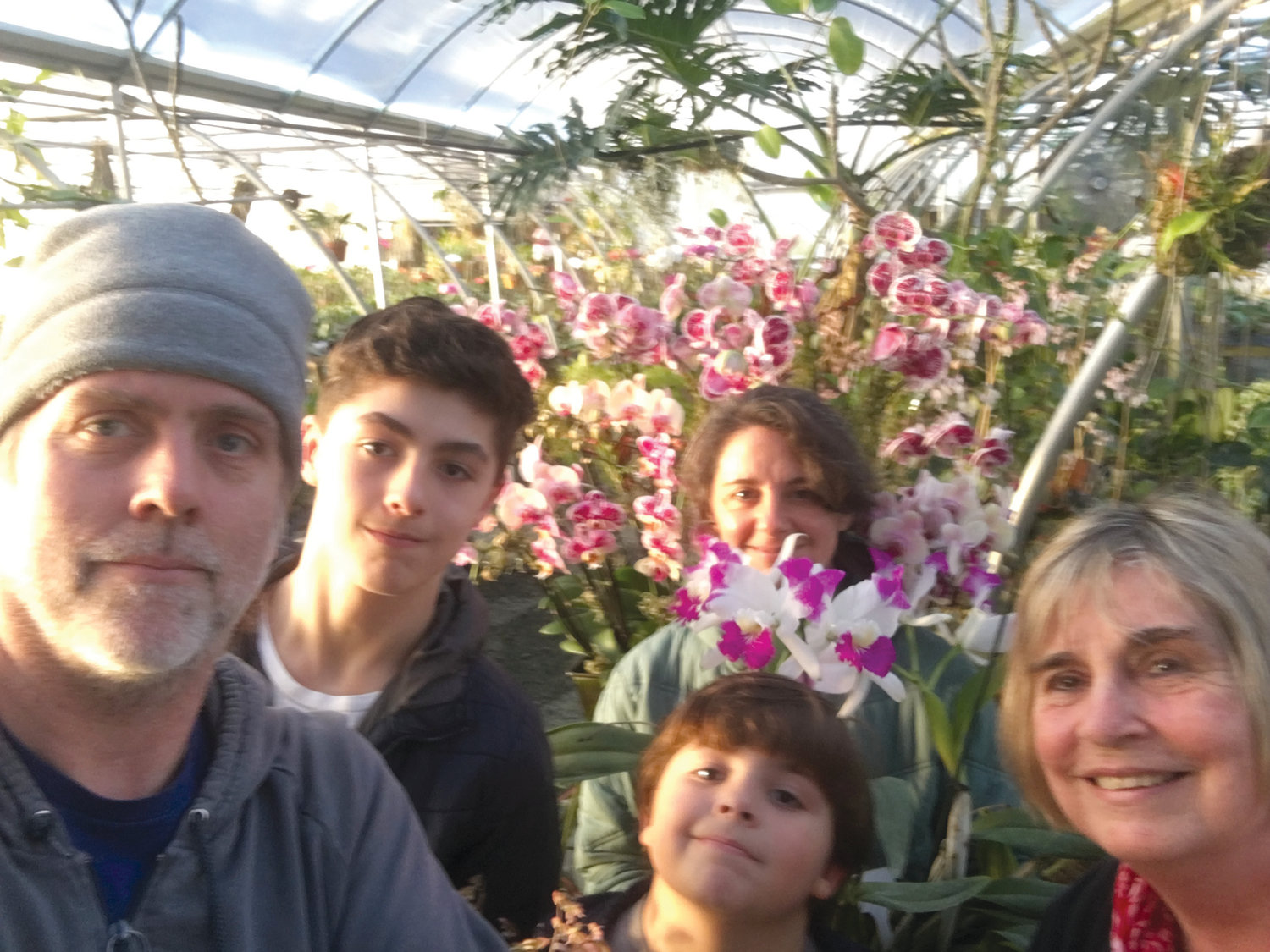 The Baldwin family is a busy crew, but they managed to get them all together for a photo in the greenhouse. From left: Jeff Baldwin, Otto Baldwin, Lucas Baldwin (bottom), Agustina Baldwin, and Rita Baldwin.