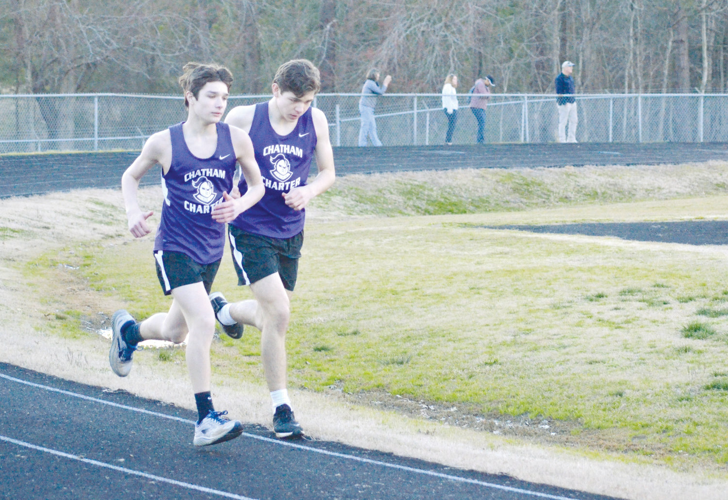 Chatham Charter distance runners Noah Lambert and Luke Fuller make their way down the track in Tuesday's track and field event at Chatham Central high school.