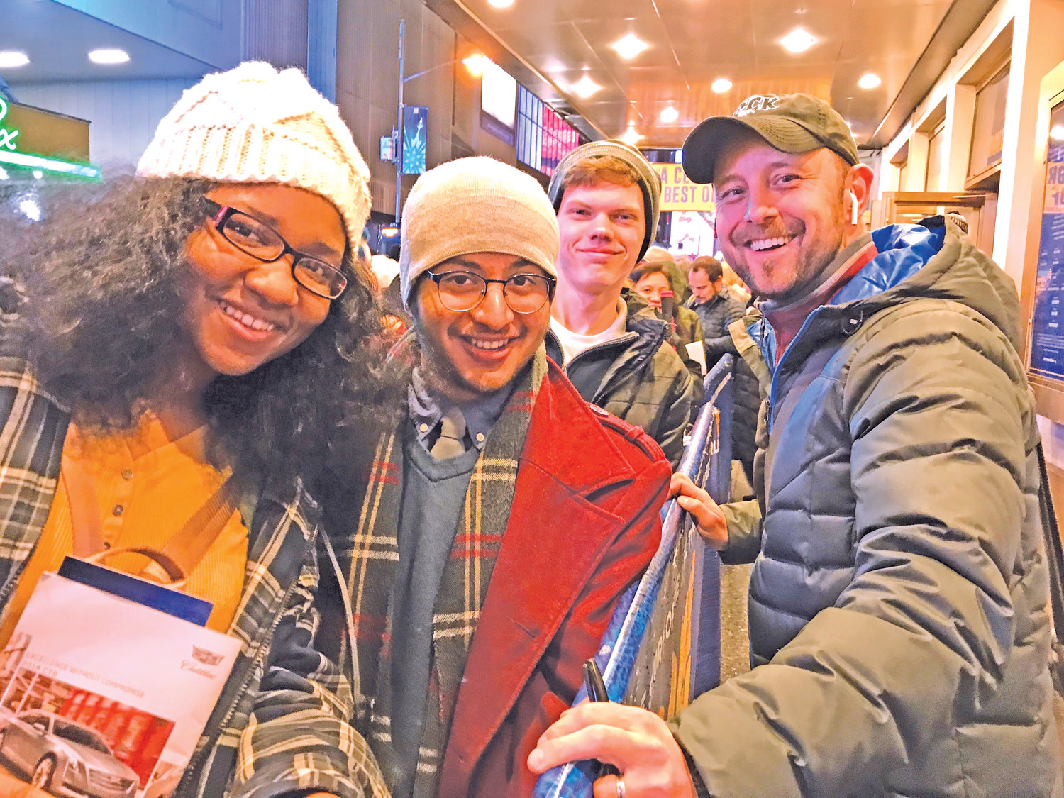 Gabrielle Campbell (from left) Joseph Lozada and Aaron Partin enjoy a quick meeting at the stage door with actor Geno Carr after seeing his performance in the hit Broadway musical, 'Come From Away,' during the JM Arts 2018 trip to New York City.