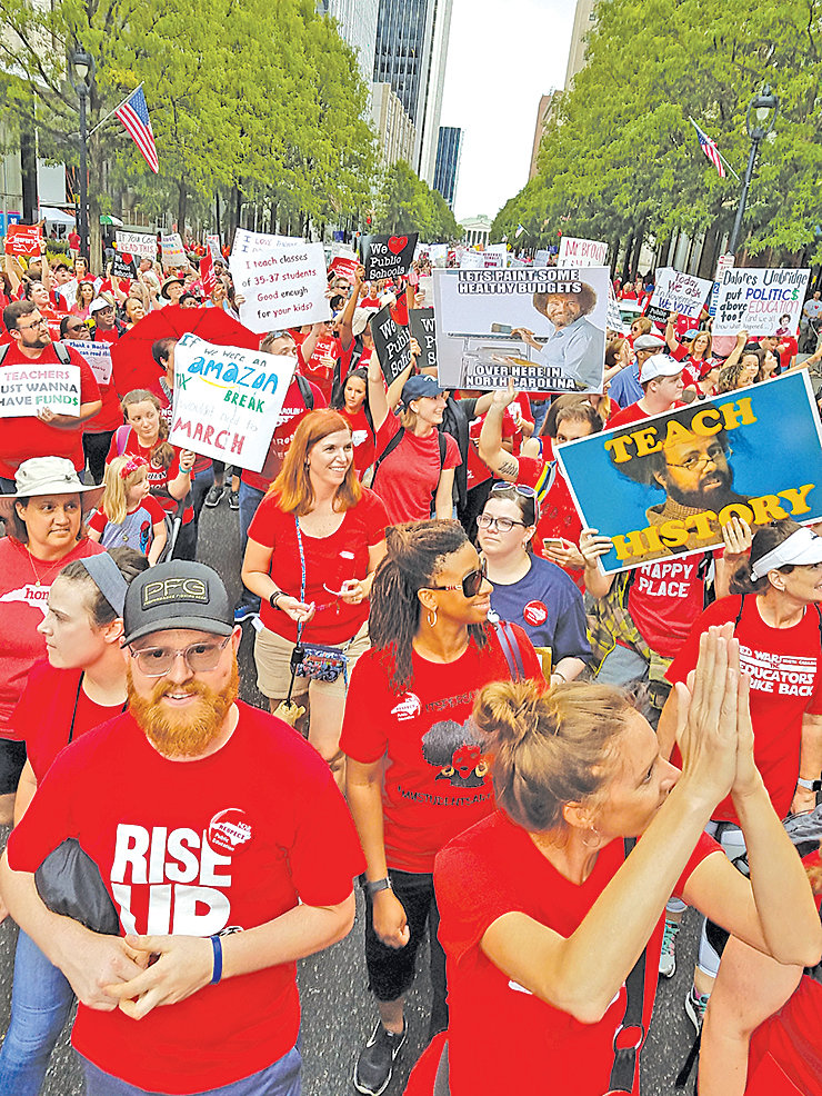 Teachers from across North Carolina gathered en masse in Raleigh last May asking state lawmakers for more funding. Many educators are expected to return to Raleigh on May 1 for 'A Day of Action for public education.'