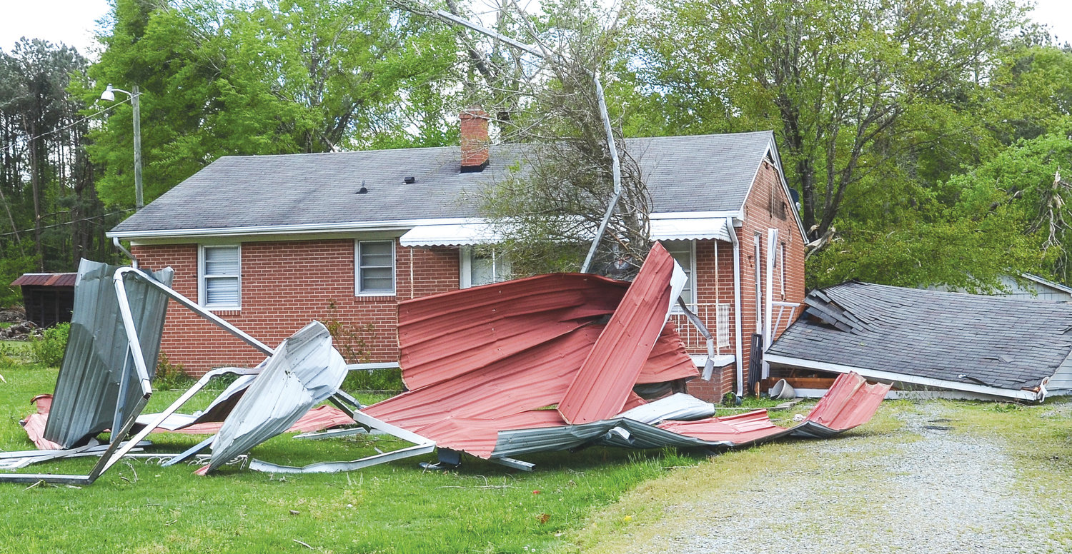 A home in Siler City lost a garage roof and paneling during Friday's storm. An EF-1 tornado hit the city, with winds that could have reached 110 mph.