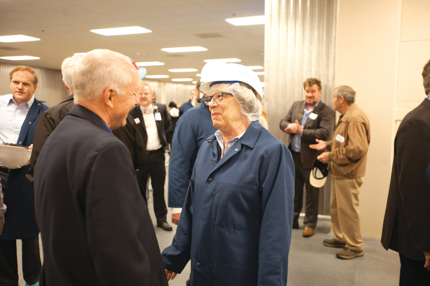 Linda Harris and Bob Kenney shared a few moments during the ribbon cutting at the new Mountaire plant in Siler City on April 16.