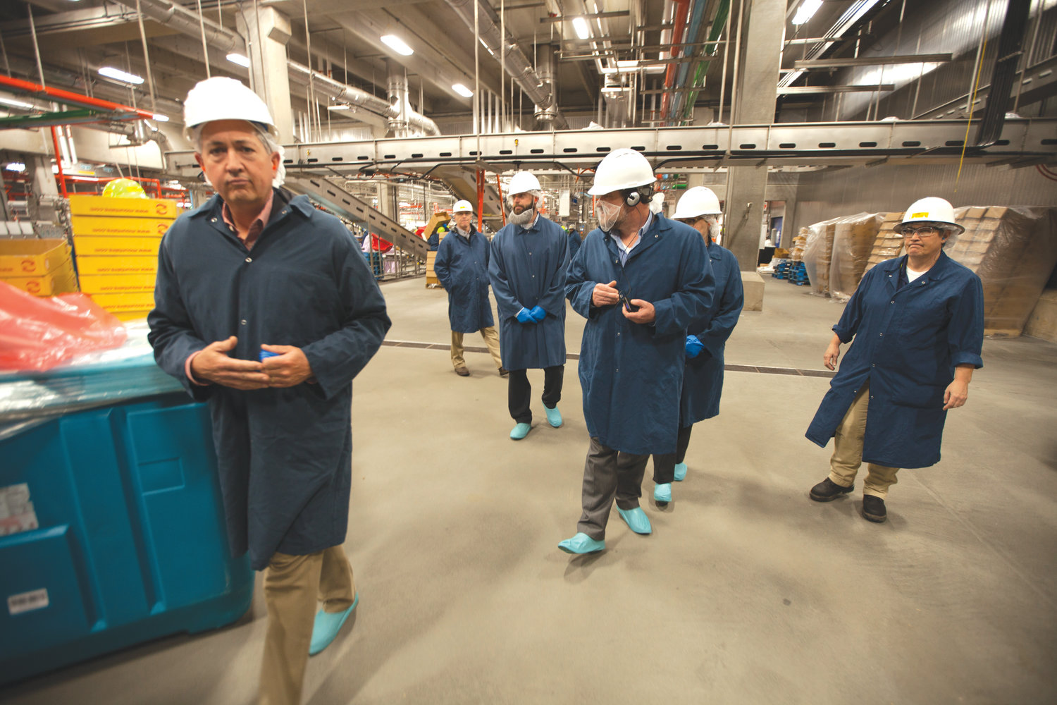 After getting a hard hat and other protective gear, visitors on the plant tour saw the start of the process of creating the packages of chicken seen in stores.
