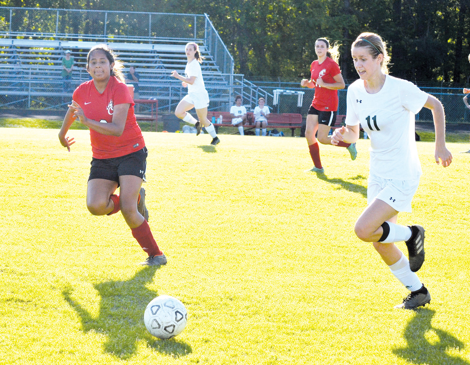 Chatham Central's Reyna Baruch, left, runs to defend the ball against Woods Charter's Eloise Maclean in Wednesday's match at Chatham Central. Woods defeated the home team 9-0.