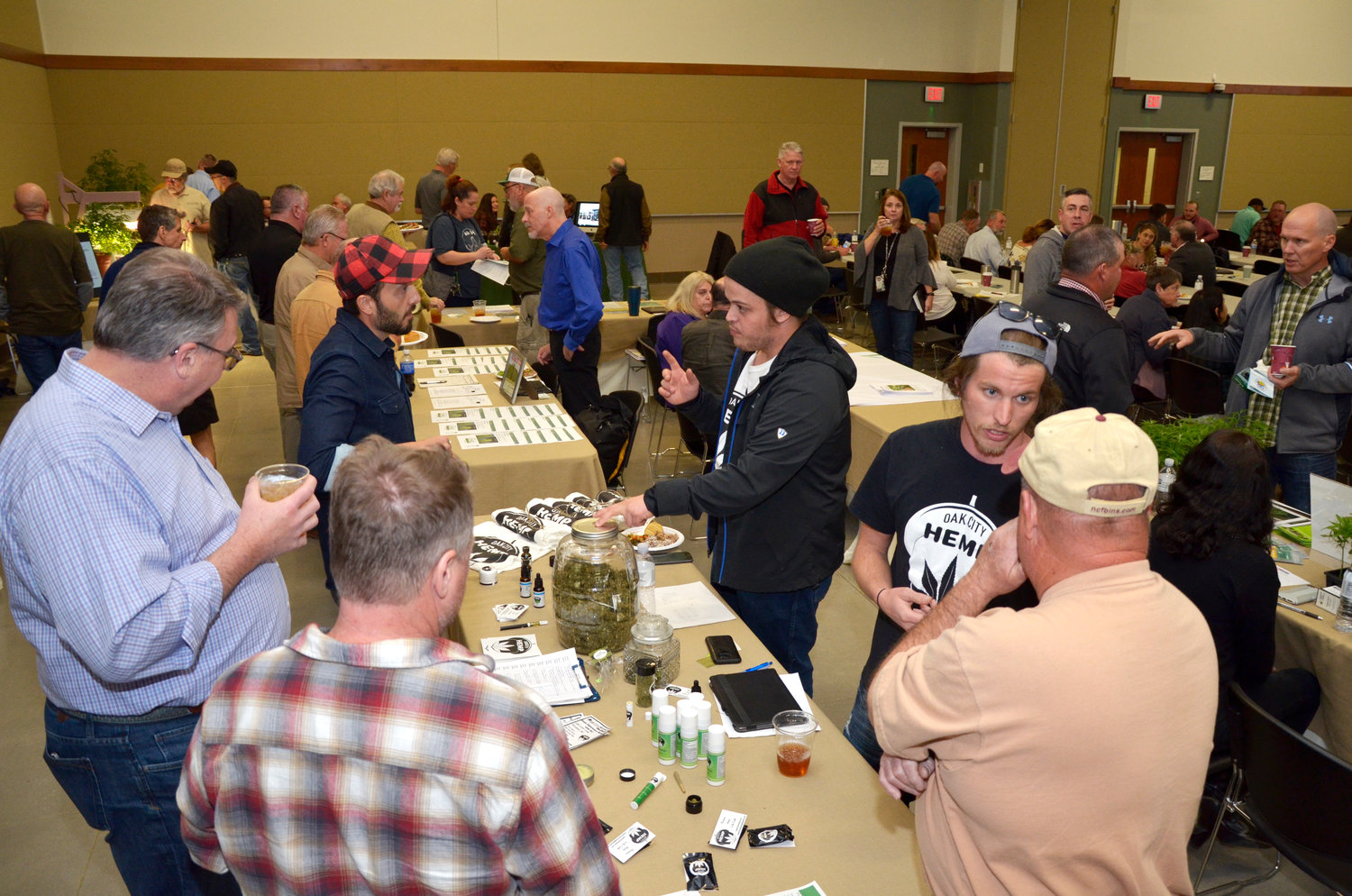 Exhibitors from Hemp production industry companies talk with participants about the value of their products.  The conference couldn't be offered just two years ago because of the attorney general (?) of the state wouldn't allow it due to federal regulations.