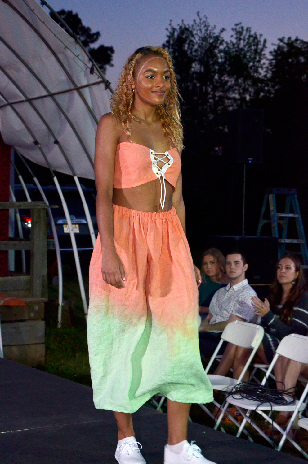 Connections to previous generations are seen in the tie-die throwbacks offered in one designers collection Saturday at the East Coast Runway Saturday night in Pittsboro.