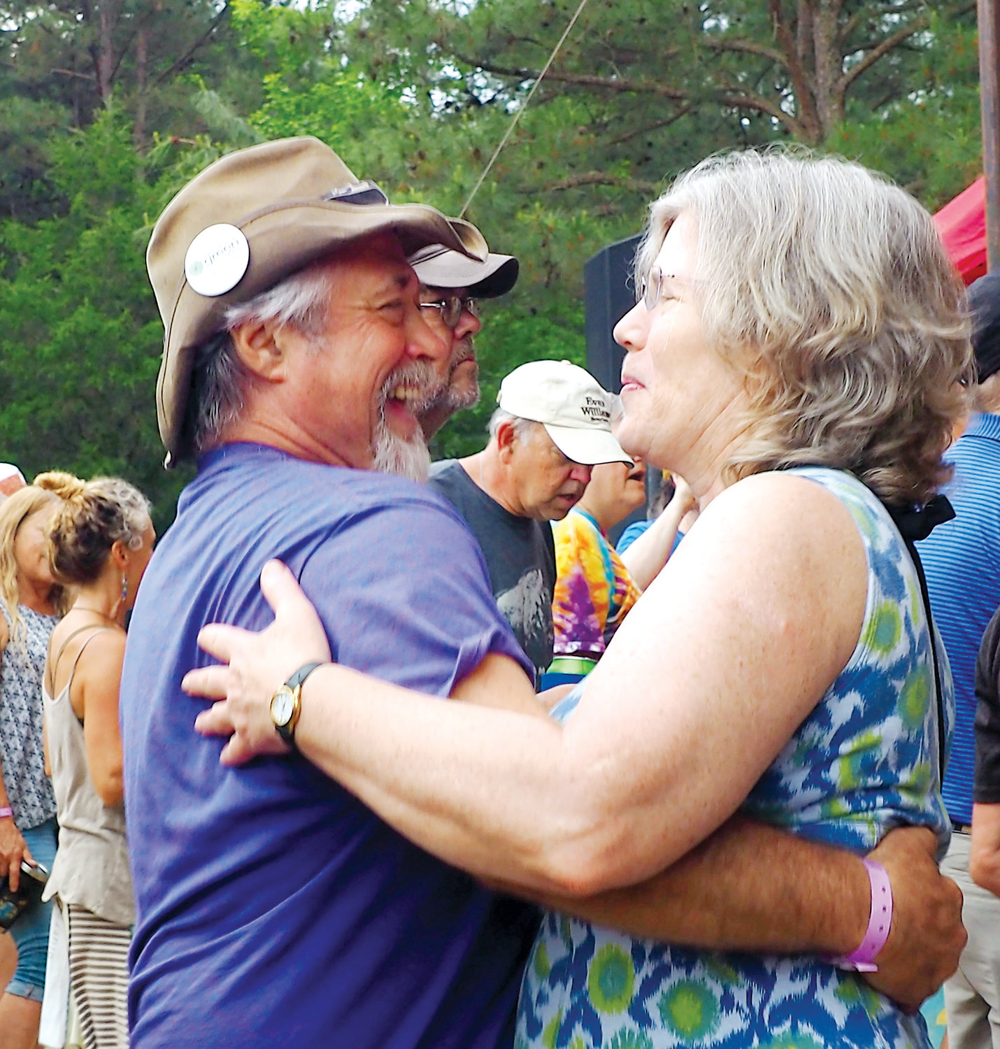Pierre Lauffer and Cindy Shea of Pittsboro dance to tunes, enjoying the afternoon at Shakori.